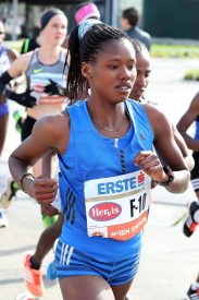 Angela Tanui Flying Kenyan Flag at Scotiabank Toronto Waterfront Marathon